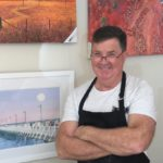 Pete Martin Artist painting in his Studio